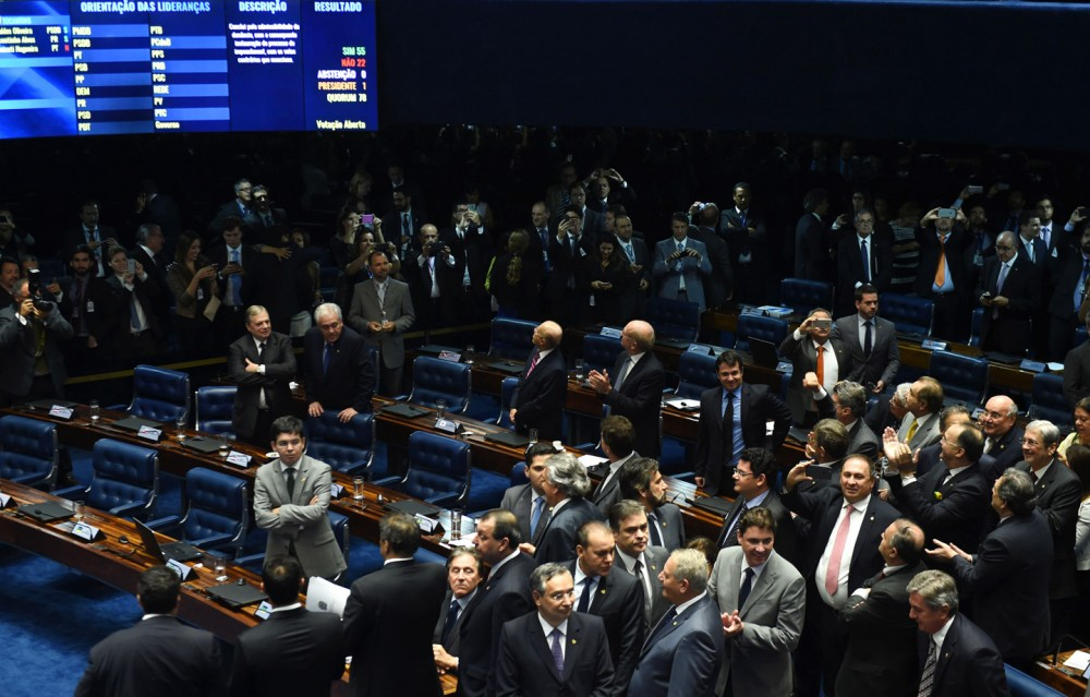 The final 55-22 Senate vote to suspend Brazilian President Dilma Rousseff and launch an impeachment trial is pictured on a screen inside the Senate in Brasília on May 12, 2016. Photo: Evaristo Sa/AFP/Getty Images