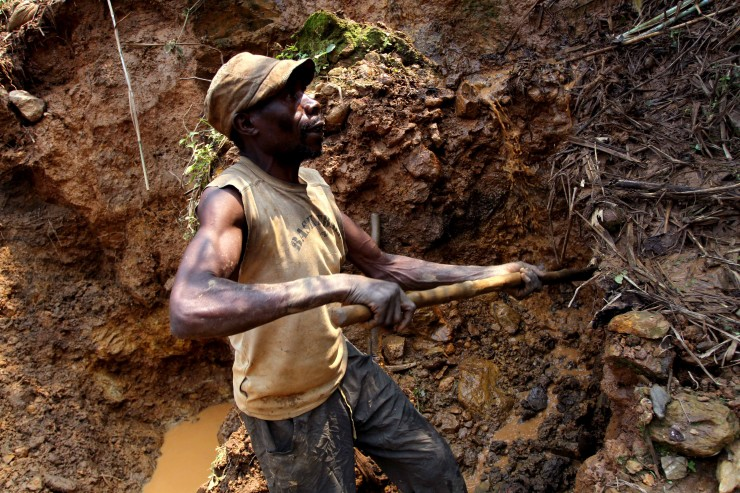 In this photo taken Aug. 17, 2012, one of the few remaining miners digs out soil which will later be filtered for traces of cassiterite, the major ore of tin, at Nyabibwe mine, in eastern Congo. Gold is now the primary source of income for armed groups in eastern Congo, and is ending up in jewelry stores across the world, according to a report published Thursday, Oct. 25, 2012, by the Enough Project. CREDIT: AP Photo/Marc Hofer