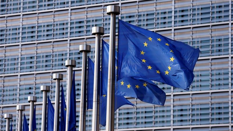 European Union flags flutter outside the EU Commission headquarters in Brussels, Belgium [Reuters]