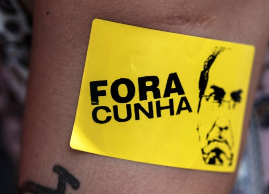 """A supporter of Brazilian President Dilma Rousseff with a sticker reading """"Cunha out,"""" in Rio de Janeiro, Brazil, on Dec. 8, 2015. Photo: Yasuyoshi Chiba/AFP/Getty Images"""