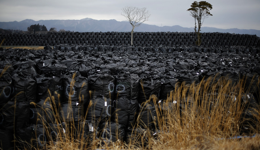 Big black plastic bags containing radiated soil, leaves and debris from the decontamination operation are dumped at a temporary storage site in Tomioka town, Fukushima prefecture, near Tokyo Electric Power Co's (TEPCO) tsunami-crippled Fukushima Daiichi nuclear power plant © Toru Hanai / Reuters