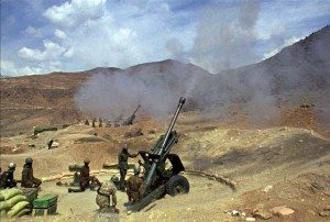 Indian army soldiers fire artillery in the northernmost part of the Kargil region, India. (AP Photo/Aijaz Rahi)