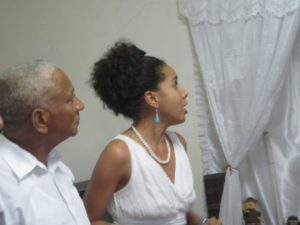 Babalawo and anthropologist Ernesto Valdez Janet and his niece Janet perform a song praising the Orishas at Proyecto Orunmila in Regla. – Photo courtesy of Marilyn Langlois