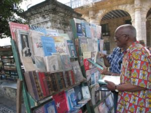 Professor and Afro-Latino scholar and activist Willie Thompson stops at a bookstand in Plaza de Armas, Habana. – Photo courtesy of Tarnel Abbott