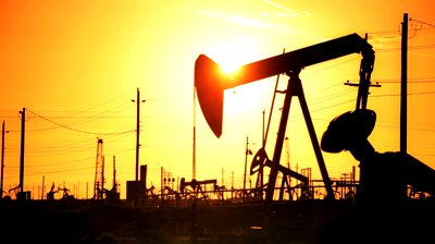 stock-footage-pump-jacks-in-perpetual-motion-drilling-for-crude-oil-in-desert-location-at-sunset