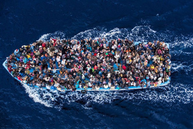 Hundreds of refugees and migrants aboard a fishing boat moments before being rescued by the Italian Navy as part of their Mare Nostrum operation in June 2014. Photo: The Italian Coastguard/Massimo Sestini | Source: UN News Centre