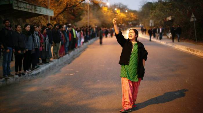 Teachers and students form a human chain inside Jawaharlal Nehru University campus in Delhi on 14 February 2016, to protest against the arrest of student union president Kanhaiya Kumar and the government crackdown on student movements. Source: photograph by Oinam Anand (Indian Express).