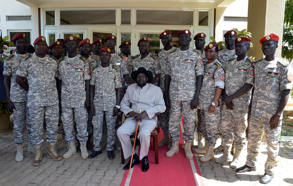 President Salva Kiir, center, poses for a photo with members of the presidential guard during a meeting in Juba, South Sudan, on Dec. 28, 2014. Photo: Photo by Samir Bol/Anadolu Agency/Getty Images