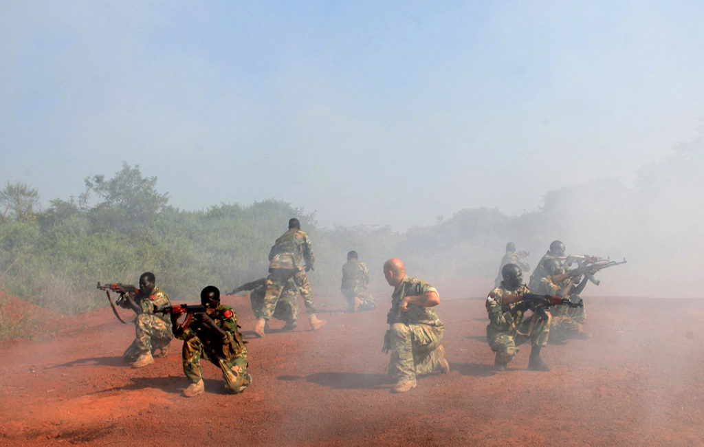 A U.S. Special Forces trainer supervises a military assault drill for a unit of the Sudan People's Liberation Army, conducted in Nzara, South Sudan, on Nov. 29, 2013. Photo: Andreea Campeanu/Reuters/Newscom