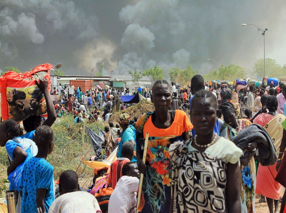 South Sudanese civilians flee fighting in the northeastern town of Malakal, where gunmen opened fire on people sheltering inside a United Nations base on Feb. 18, 2016. Photo: Justin Lynch/AFP/Getty Images