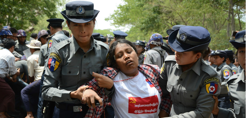 In the photo, a labor demonstrator is arrested by police in Tetkone township on May 18, during a protest march to central Naypyidaw. Photo credit: AUNG HTET/AFP/Getty Images