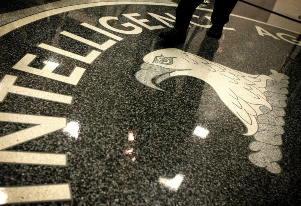 A man walks across the seal of the Central Intelligence Agency at the lobby of the Original Headquarters Building at the CIA headquarters February 19, 2009 in McLean, Virginia. (Photo by Alex Wong/Getty Images)