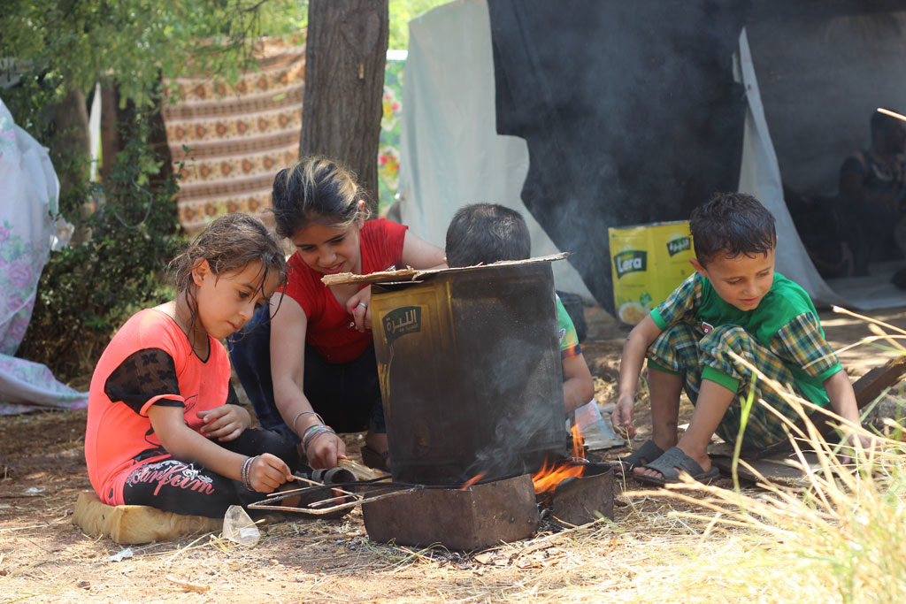 Children prepare a fire for cooking in Aleppo city, Syria. As of 2 August 2016, children are again facing terrible threats from new intense attacks and fighting in the western parts of the city. Photo: UNICEF/Khuder Al-Issa