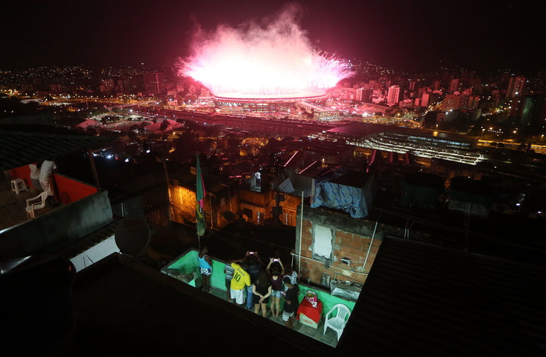 Residents of Mangueira, a favela in Rio de Janeiro, watched the opening ceremony of the Olympic Games on Aug. 5. Credit Mario Tama/Getty Images
