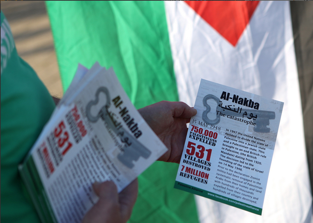The group Palestine Alliance handed out leaflets outside the stadium before the match began (Reuters)