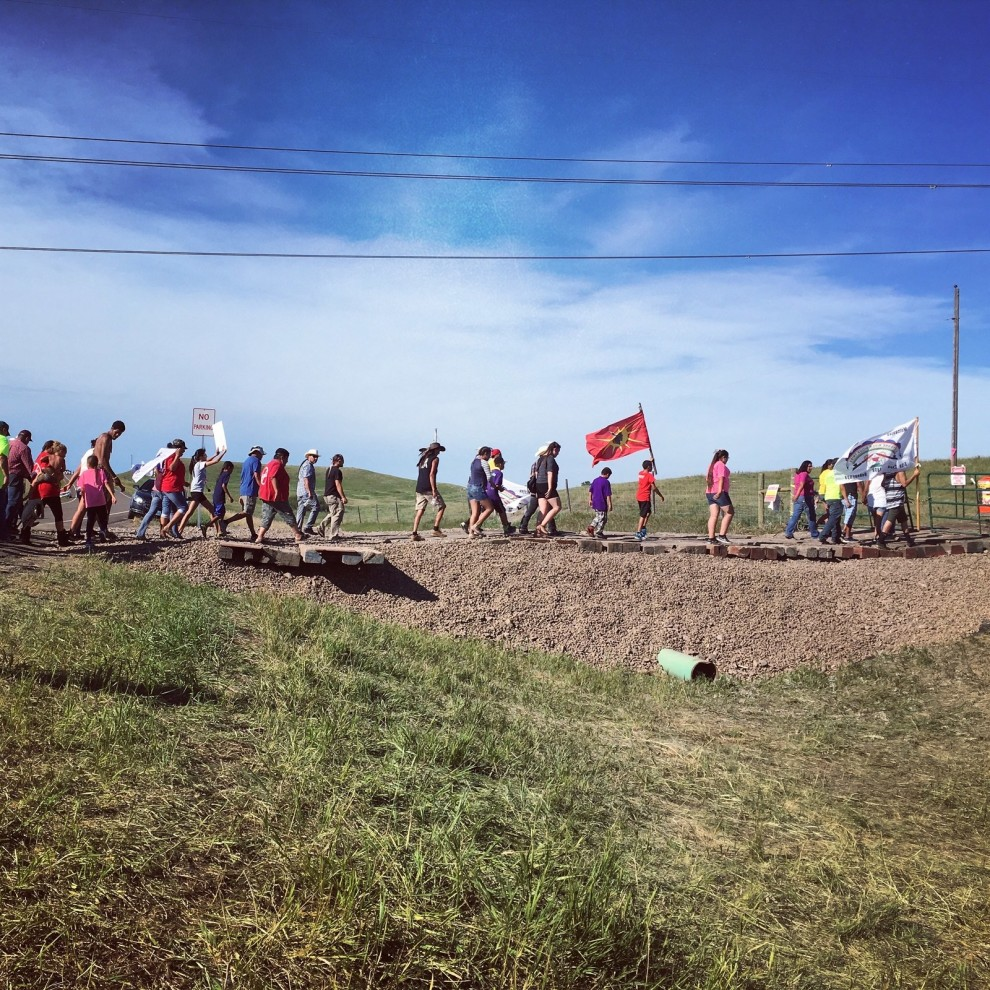 After the protesters disrupted the construction site and shut down work for the day, a group marched up to the main gates. Daniella Zalcman