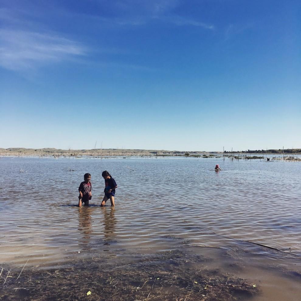 Children play in the Missouri River, a mile from the proposed construction of the Dakota Access Pipeline. Daniella Zalcman