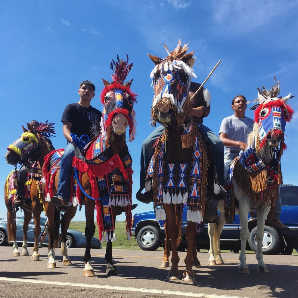 Horses and riders from the Rosebud reservation arrive to support the Standing Rock community. The horses are in traditional Lakota regalia. Daniella Zalcman