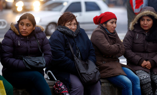 Demonstrators huddle against the cold during a protest over electricity and gas prices in Buenos Aires this year. Marcos Brindicci/Reuters