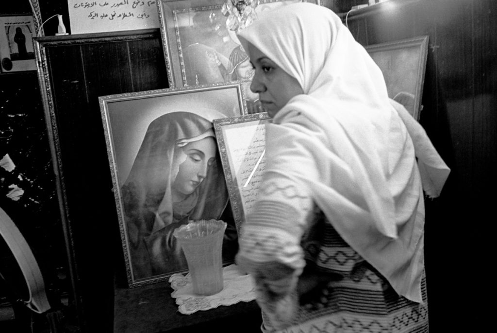 A Muslim woman asking for protection from black magic inside the shrine of Abba Ruwais, a Copt saint, Cairo, Egypt, 1997. Abbas/Magnum Photos