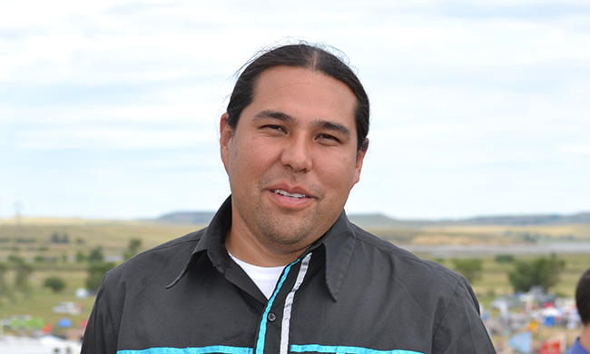 Dallas Goldtooth is the Keep It In The Ground campaign organizer for the Indigenous Environmental Network. Photo by Sarah van Gelder.