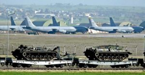 A Turkish military train with tanks passes by US Airforce planes at Incirlik air base in Adana southeastern Turkey. PHOTO EPA BASRI BAS TT ms