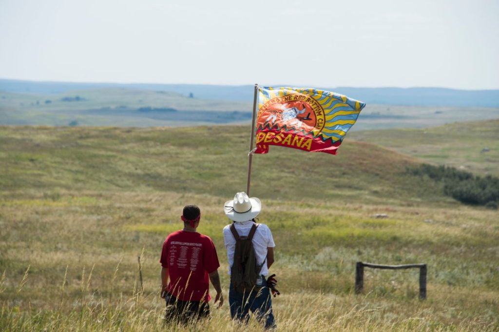 Native American protestors wave a clan flag over land designated for the Dakota Access Pipeline, on September 3, 2016, near Cannon Ball, North Dakota. ROBYN BECK—AFP/Getty Images