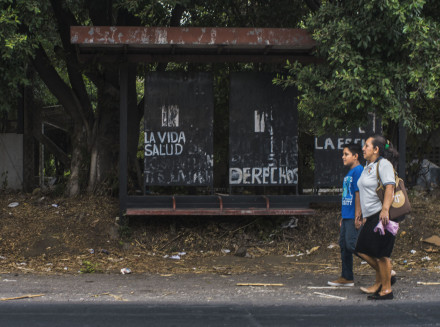 "The bus stop in front of the battery factory with graffiti painted by community activists: ""LIFE, HEALTH,"" ""RIGHTS."" Juan Carlos for BuzzFeed News"