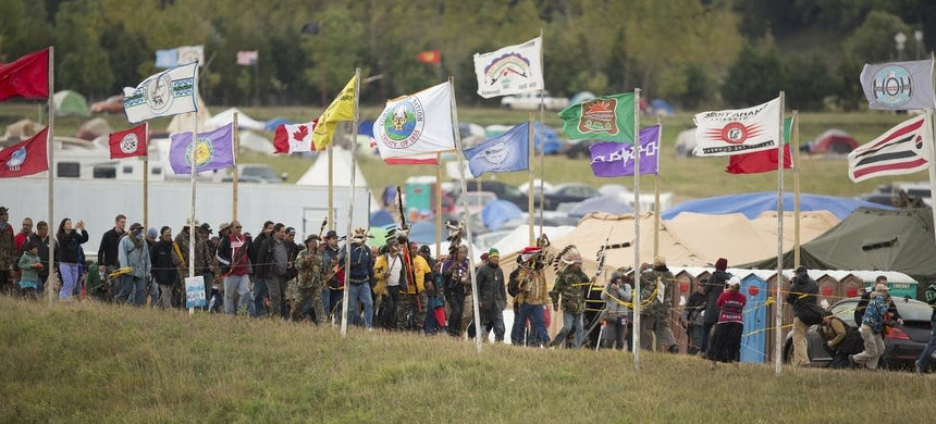 Land and Water Defenders: The flags of many tribal nations fly at the overflow camp at the site of the Dakota Access Pipeline. (photo: Christopher Juhn/MPR)