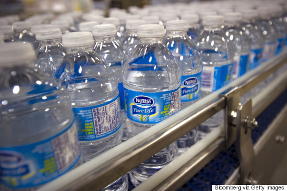 Bottles of Pure Life brand water move on the production line at the Nestle Waters Canada plant near Guelph, Ont. in January 2015. (Photo: Bloomberg via Getty Images)