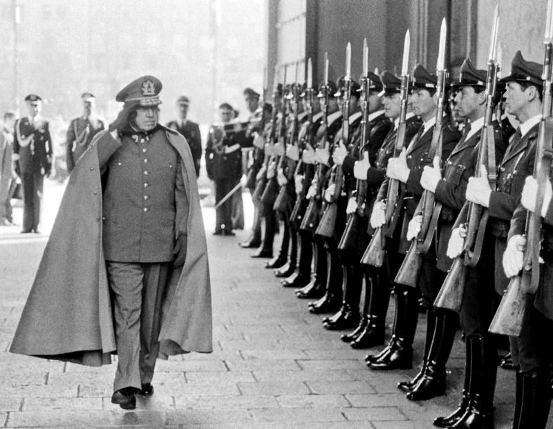 Caesar Augusto: Pinochet reviews troops inside the presidential palace in Santiago. Martin Thomas / Courtesy Reuters