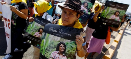 An Indigenous woman holds a poster with a photograph of Berta Caceres during a march to demand justice in Tegucigalpa, Honduras. photo: Reuters