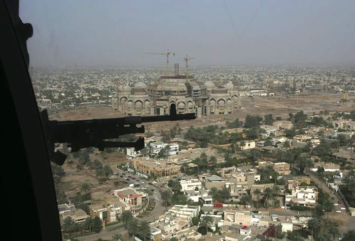 A US helicopter flies over Baghdad on its way to Camp Victory in March 2006. Photo by Ali Jasim/Reuters