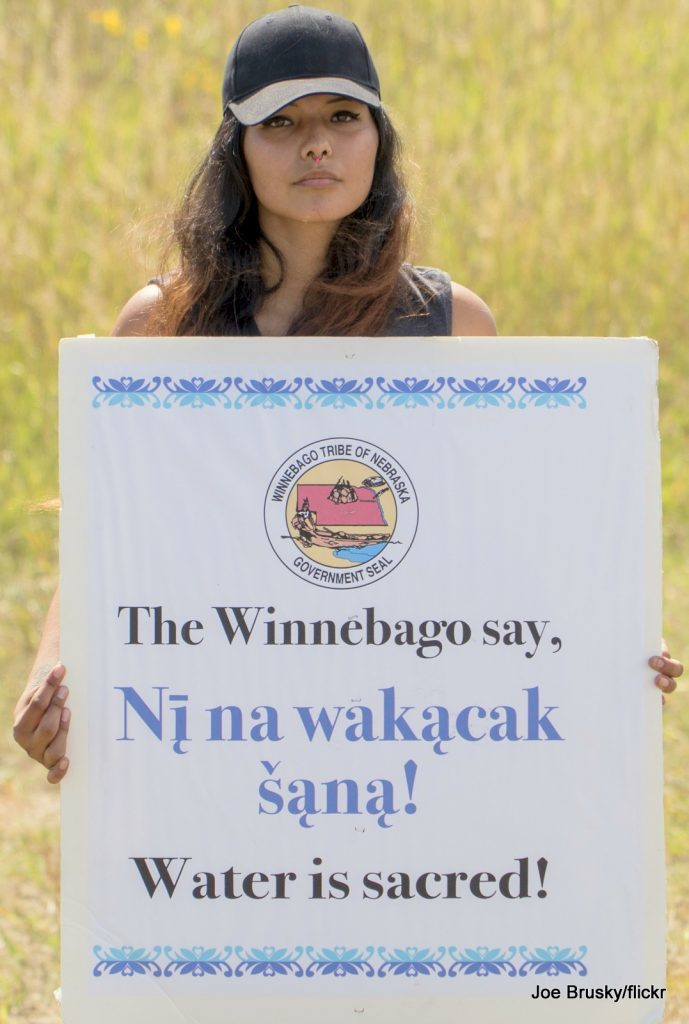 A Winnebago woman protests against the Dakota Access Pipeline in Canon Ball, ND.