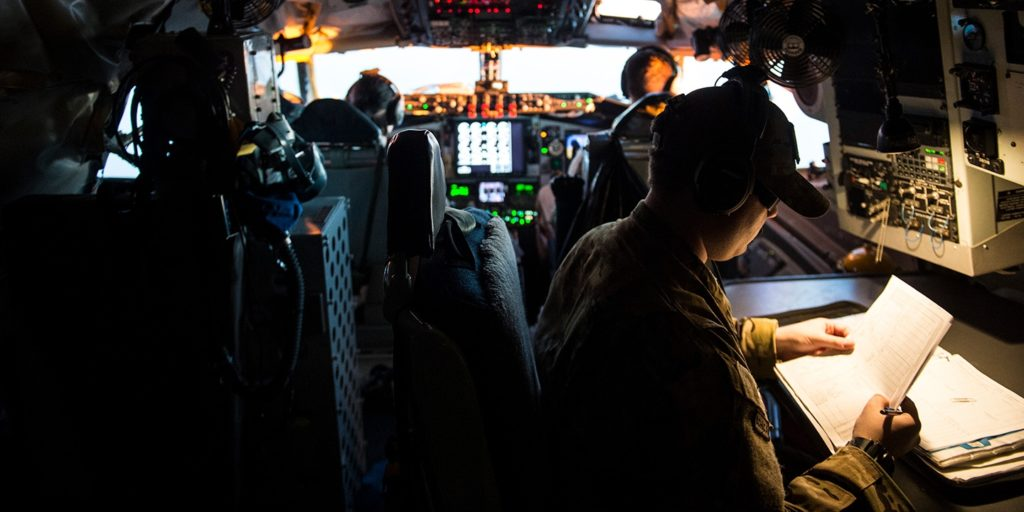 A member of the U.S. Air Force looks over flight paperwork inside a KC-135 Stratotanker flying over Iraq on March 17, 2016, in support of Operation Inherent Resolve. Staff Sgt. Corey Hook/U.S. Air Force