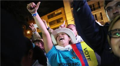 'No' supporters celebrate at a rally following their victory in the referendum on a peace accord in Bogota, Colombia [Getty]