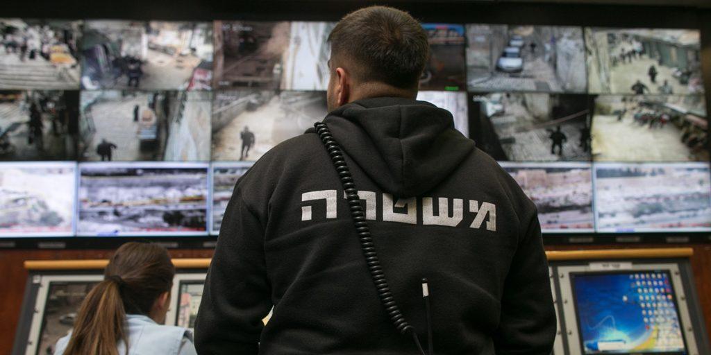 People observe surveillance cameras on screens inside the Jerusalem Police's Mabat 2000 unit on Nov. 17, 2015, in Jerusalem. Photo: Ohad Zwigenberg