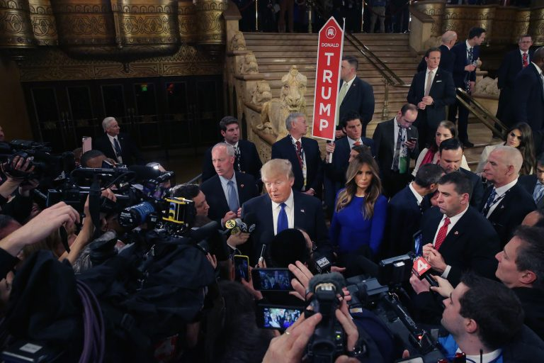 Photo of Donald Trump greeting reporters in the spin room following a debate sponsored by Fox News at the Fox Theatre on March 3, 2016 in Detroit, Michigan, by Chip Somodevilla/Getty Images
