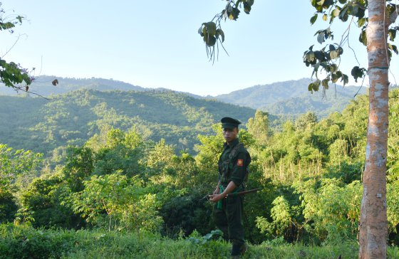 A Kachin Independence Army (KIA) soldier seen at Lawa Yang frontline post. The Burma Army is stationed on the hills in the background. Paul Vrieze