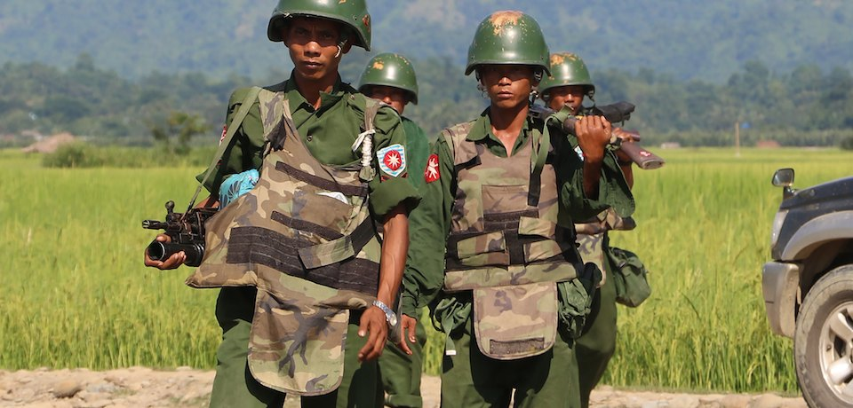 Myanmar soldiers on patrol in Maungdaw, Rakhine State, on October 21, 2016. Stringer/AFP/Getty Images