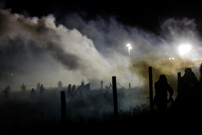 Police used tear gas on demonstrators opposed to the Dakota Access oil pipeline in North Dakota, on Sunday. Credit Stephanie Keith/Reuters