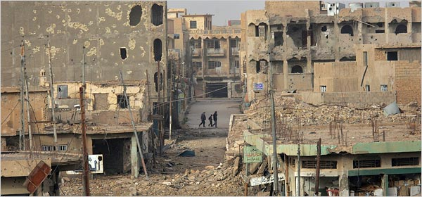 A city street in Ramadi heavily damaged by the fighting in 2006. Joey Buccino at English Wikipedia | Creative Commons Attribution-Share Alike 3.0 Unported license.